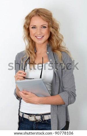 Beautiful woman with eyewear using electronic tablet - stock photo