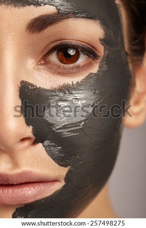 Beautiful woman with facial mask.  - stock photo