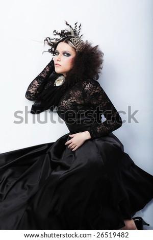 Beautiful woman with fashion hairstyle wearing black dress - stock photo