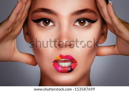 Beautiful woman with fashion makeup - stock photo
