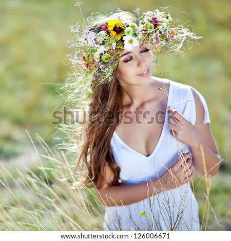 Beautiful woman with flower wreath. - stock photo