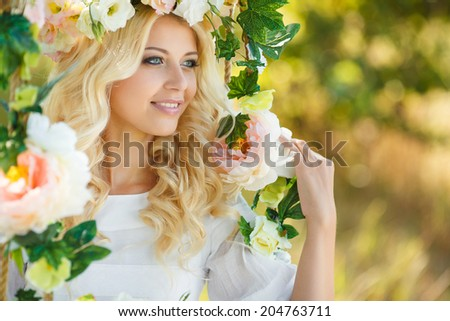 Beautiful woman with flower wreath.Beautiful women in the countryside.Portrait of beautiful young girl outdoors in spring - stock photo