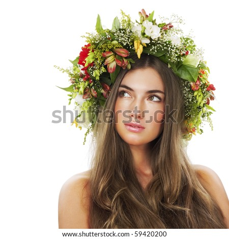 Beautiful woman with flower wreath. Space for text. - stock photo