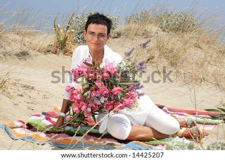 beautiful woman with flowers - stock photo
