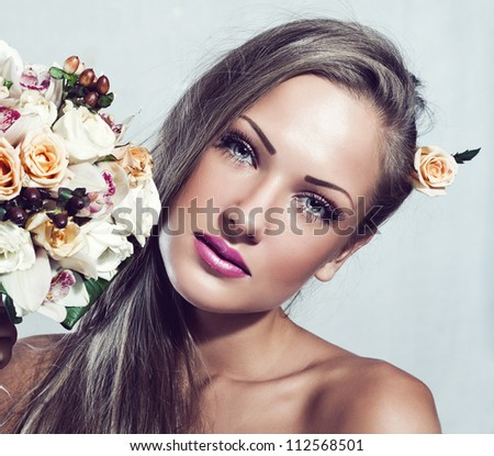 beautiful woman with flowers , makeup - stock photo