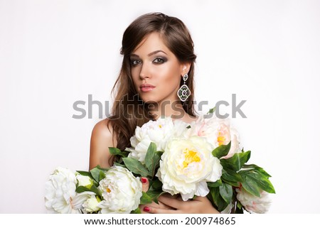 Beautiful woman with flowers on white background