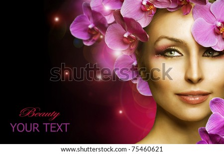 Beautiful Woman with Flowers over black - stock photo