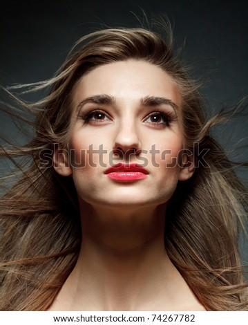 Beautiful woman with flowing hair - stock photo