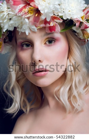 Beautiful woman with fresh flowers (Alstroemeria and  Chrysanthemum Zembla) in hair - stock photo