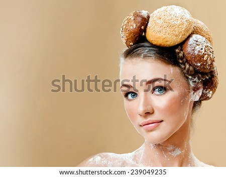 Beautiful woman with fresh fragrant bread. Crispy rolls. Bread Baking.