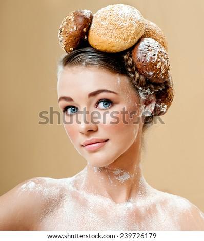Beautiful woman with fresh fragrant bread. Crispy rolls. Bread Baking. - stock photo