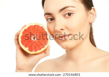 Beautiful woman with fresh grapefruit isolated on white - stock photo