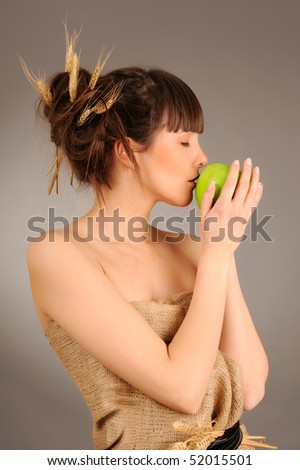 Beautiful woman with fresh green apple. Eco concept. - stock photo