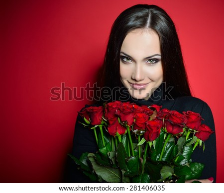 Beautiful Woman with Fresh Red Roses. Girl and Flowers over Red Background. Beauty Female Face. Happiness, Freshness, Beauty, Youth.