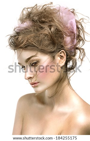 Beautiful woman with fresh shiny skin, sensual lips and romantic wavy hairstyle  - stock photo