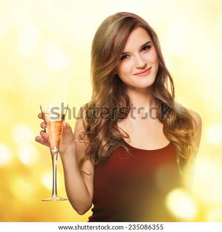 Beautiful woman with glass of champagne - stock photo