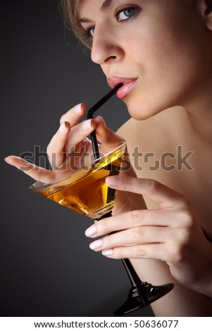 Beautiful woman with glass of cocktail - stock photo