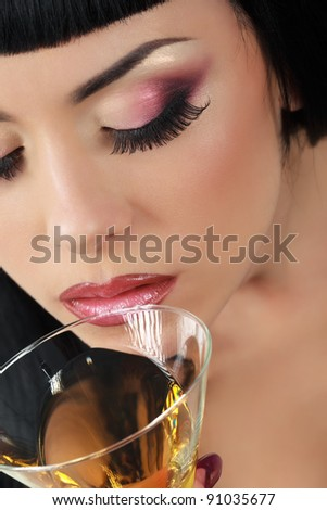 Beautiful woman with glass of cocktail.Top view - stock photo
