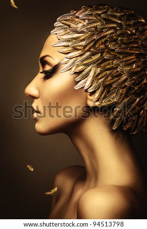 beautiful woman with gold feather hat - stock photo