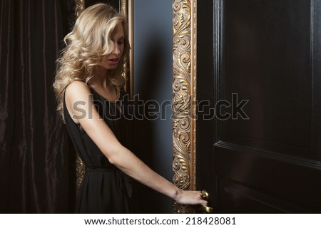 Beautiful woman with golden curls - stock photo