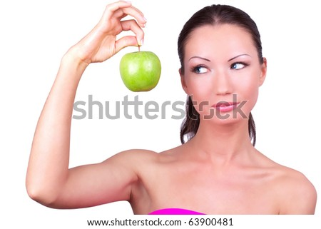 Beautiful woman with green apple in hand, closed-up on white