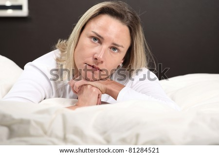 Beautiful woman with grim thoughtful expression, horizontal face closeup