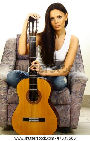 beautiful woman with guitar - stock photo