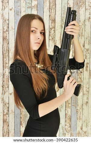 Beautiful woman with gun - stock photo
