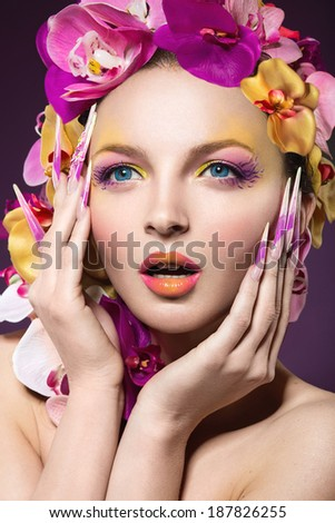 Beautiful woman with hair made of flowers and long nails