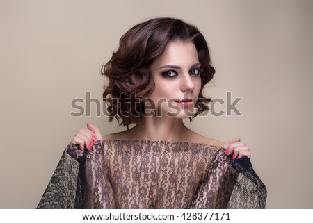 beautiful woman with hair styled as retro pop
