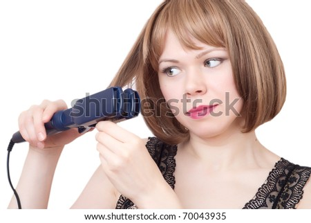 Beautiful woman with hairdryer on a white background - stock photo