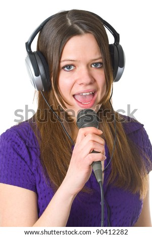 Beautiful woman with headphone and microphone isolated on white background - stock photo