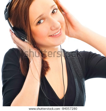 Beautiful woman with headphones, she is listen to the music. Isolated on white background - stock photo