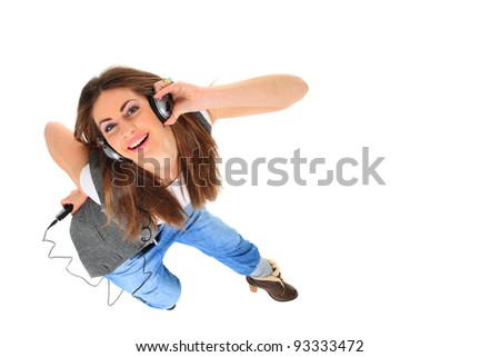 Beautiful woman with headphones, she is listen to the music top view - stock photo