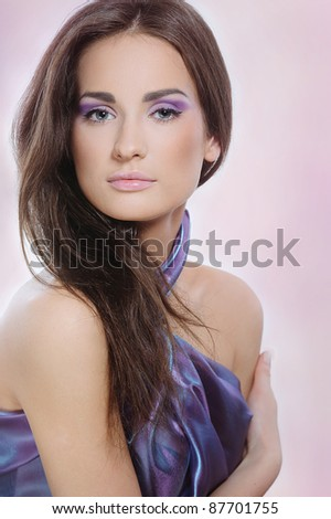 Beautiful woman with health skin in violet color dress to celebrate - stock photo