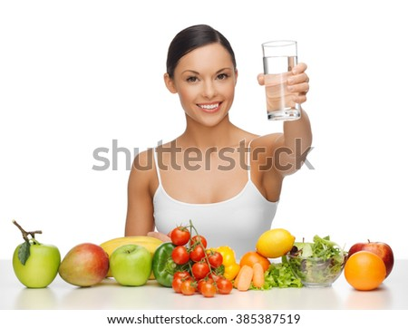 beautiful woman with healthy food and water - stock photo