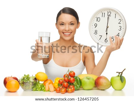 beautiful woman with healthy food water and clock - stock photo