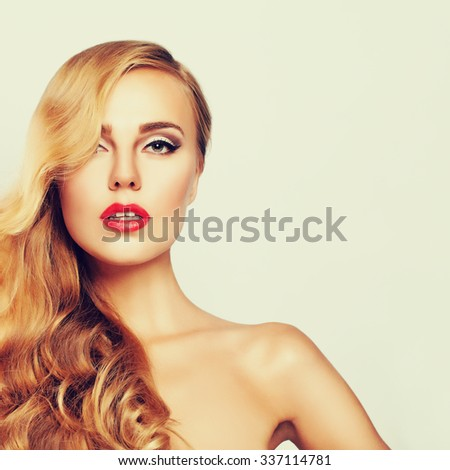 Beautiful Woman with Healthy Skin and Long Blond Hair - stock photo