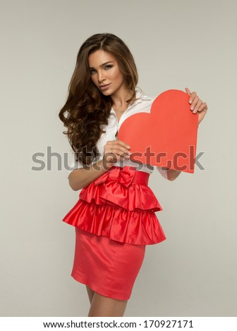 Beautiful woman with heart - stock photo