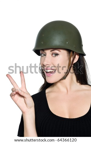 beautiful woman with helmet army soldier saluting peace on studio isolated background