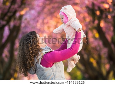 Beautiful woman with her baby girl - stock photo