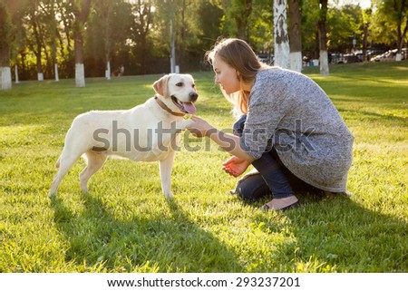 Beautiful woman with her dog. - stock photo