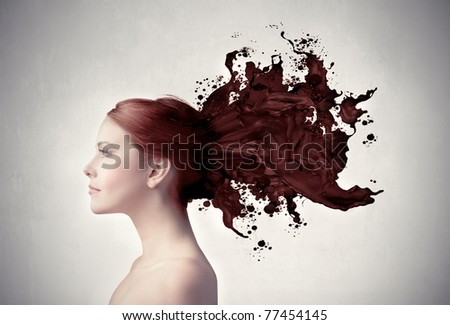 Beautiful woman with her hair melting in brown paint - stock photo