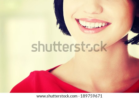 Beautiful woman with  her perfect straight white teeth.  - stock photo