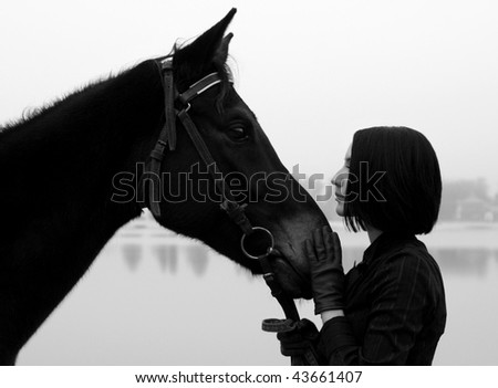 Beautiful woman with horse in black and white