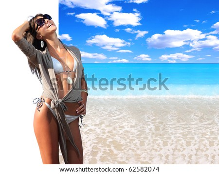 Beautiful woman with ideal beach landscape  - Clipping path on the girl easy to cut her out - perfect for travel agencies