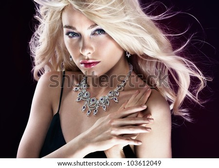Beautiful woman with jewellery - stock photo