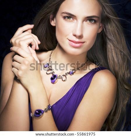 Beautiful woman with jewelry - stock photo