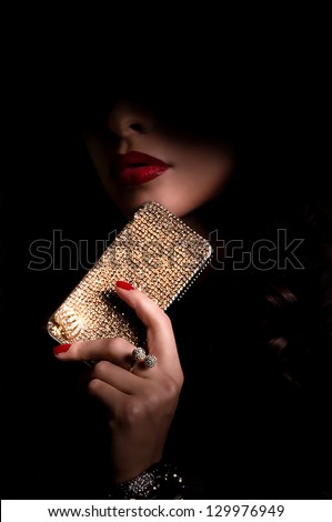 Beautiful woman with jewelry bijouterie in dark. Fashion portrait - stock photo