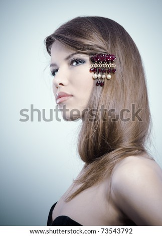 Beautiful woman with jewelry in her hair - stock photo